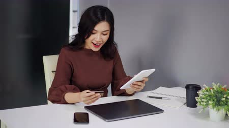 freitag : happy woman using digital tablet for online shopping with credit card Videos