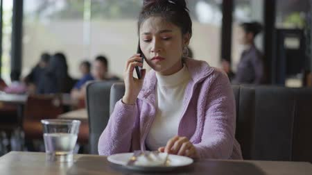 calling telephone : woman talking on mobile phone in restaurant Stock Footage
