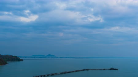 павильон : night to day time lapse of wooden bridge to the sea at Rayong,Thailand