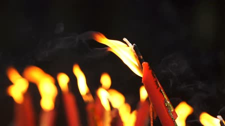 ладан : slow-motion of flame from burning red chinese candle in the temple Стоковые видеозаписи