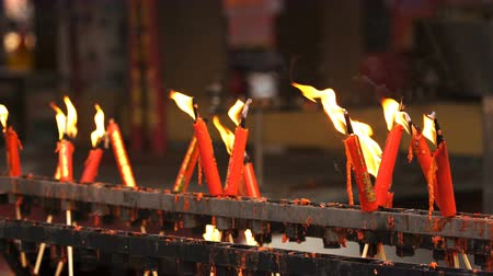 saygı : flame from burning red chinese candle in the temple Stok Video