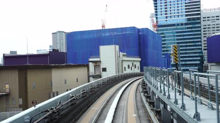 tokyo station : Time-lapse of Scenery of a train traveling on the rail of Yurikamome Line in Tokyo from Shimbashi station to Odaiba. Stock Footage