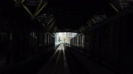 транзит : TOKYO, JAPAN - MARCH 28, 2019, Scenery of a train traveling on the rail of Yurikamome Line in Tokyo from Shimbashi station to Odaiba.