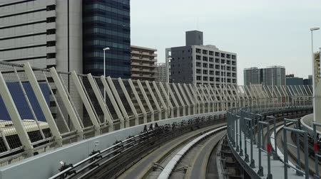 railway station : TOKYO, JAPAN - MARCH 28, 2019, Scenery of a train traveling on the rail of Yurikamome Line in Tokyo from Shimbashi station to Odaiba.