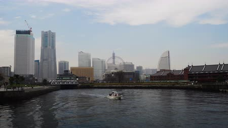 yokohama : YOKOHAMA, JAPAN - March 26, 2019: skyline of Minatomirai with boat, view from the bay in Yokohama city, Japan