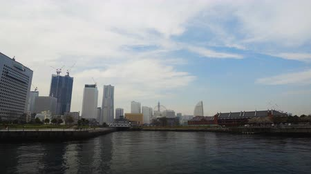 yokohama : skyline of Minatomirai, view from the bay in Yokohama city, Japan Stock Footage