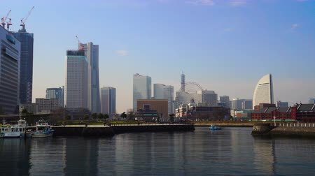 yokohama : YOKOHAMA, JAPAN - March 26, 2019: skyline of Minatomirai, view from the bay in Yokohama city, Japan