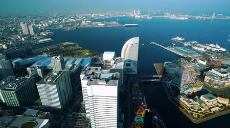 alanlar : YOKOHAMA, JAPAN - March 26, 2019: Aerial view of Yokohama Cityscape at Minato Mirai waterfront district, view from Yokohama Landmark Tower, Japan Stok Video