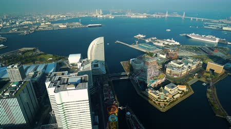 minato : YOKOHAMA, JAPAN - March 26, 2019: Aerial view of Yokohama Cityscape at Minato Mirai waterfront district, view from Yokohama Landmark Tower, Japan Stock Footage