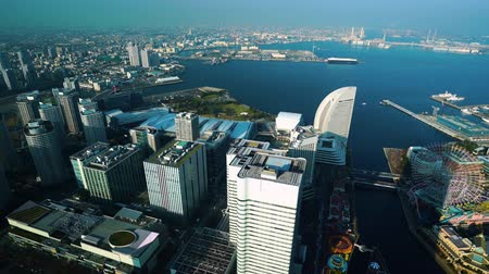 yokohama : Aerial view of Yokohama Cityscape at Minato Mirai waterfront district, view from Yokohama Landmark Tower, Japan Stock Footage