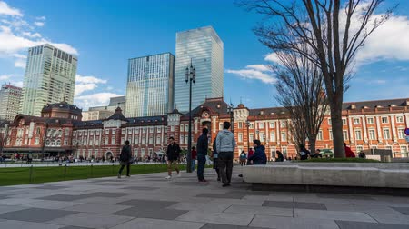 red square : TOKYO, JAPAN - March 24, 2019: time lapse of Tokyo Station in the Marunouchi business district, It is the biggest and busiest terminal station in Japan.
