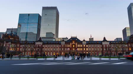 demiryolu : day to night time lapse of Tokyo Station in the Marunouchi business district, Japan Stok Video