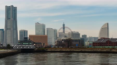 yokohama : YOKOHAMA, JAPAN - March 26, 2019 : time lapse of Minatomirai, view from the bay in Yokohama city, Japan