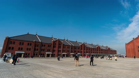 yokohama : YOKOHAMA, JAPAN - March 26, 2019: time lapse of tourist visit Yokohama Red Brick Warehouse in Yokohama Minatomirai, Japan