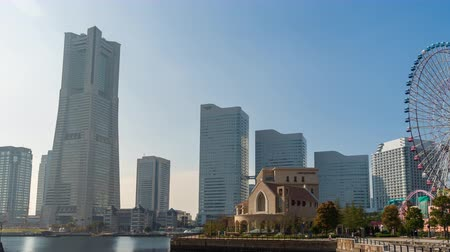 třešně : YOKOHAMA, JAPAN - March 26, 2019: time lapse of Minatomirai, view from the bay in Yokohama city, Japan