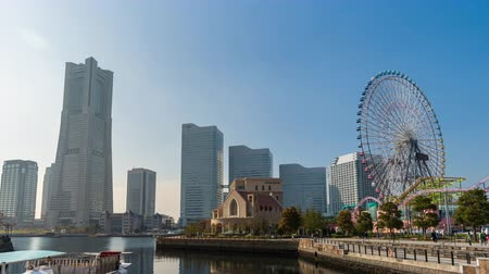 minato : YOKOHAMA, JAPAN - March 26, 2019: time lapse of Minatomirai, view from the bay in Yokohama city, Japan