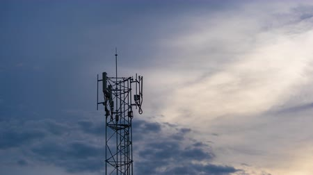 microonda : day to night time lapse of Telecommunication tower Antenna at sunset Stock Footage