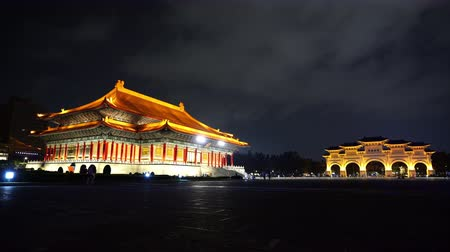concert hall : National Theater Hall and Liberty Square main gate of Chiang Kai-Shek Memorial Hall at night in Taipei, Taiwan. the famous landmark with popular travel of tourists visiting Taiwan.