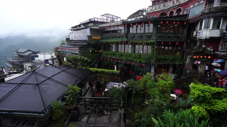 mei : Jiufen, Taiwan – 10 June, 2019: A Mei Tea House at Jiufen Old Street in raining day, Taiwan. the famous tourist spot and popular scene in Spirited Away animation ghibli studio. Stock Footage