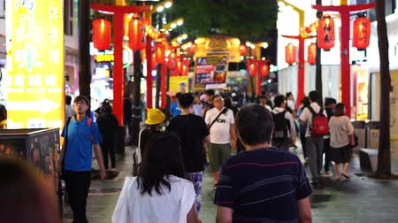 taiwan : Taipei, Taiwan- 8 June, 2019: Crowd of people walking and shopping at Ximending street market at night in Taipei, Taiwan. Ximending is the famous fashion, night Market and street food in Taipei.