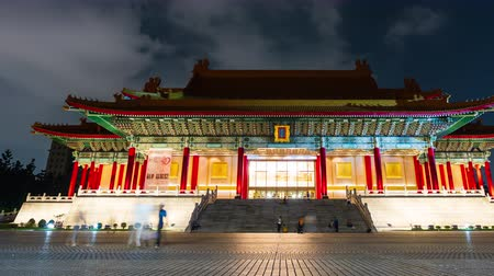 salle de concert : Taipei, Taiwan- 8 June, 2019: time lapse of Unidentified people visited National Concert Hall of Chiang Kai-Shek Memorial Hall at night in Taipei, Taiwan. the famous landmark with popular travel of tourists visiting Taiwan