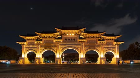 main : time lapse of Liberty Square main gate of Chiang Kai-Shek Memorial Hall at night in Taipei, Taiwan