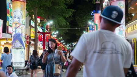 taipei : Taipei, Taiwan- 8 June, 2019: time lapse of Crowd of people walking and shopping at Ximending street market at night in Taipei, Taiwan. Ximending is the famous fashion, night Market and street food in Taipei.