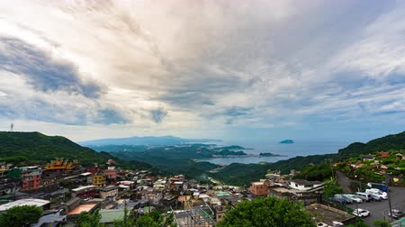 склон холма : time lapse of of Jiufen village with mountain and east china sea, Taiwan