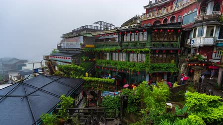 mei : Jiufen, Taiwan – 10 June, 2019: time lapse of A Mei Tea House at Jiufen Old Street in raining day, Taiwan. the famous tourist spot and popular scene in Spirited Away animation ghibli studio.