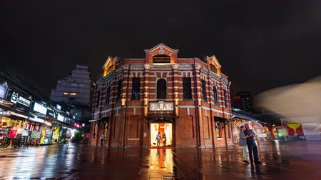 taipei : Taipei, Taiwan- 11 June, 2019: time lapse of The Red Chamber Theater or The Red House Ximen with falling rain in Ximending district at night in Taipei, Taiwan. Stock Footage