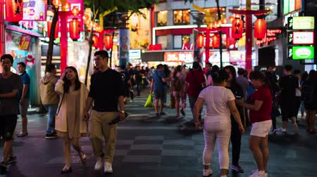 Тайваньская : Taipei, Taiwan- 11 June, 2019: time lapse of Crowd of people walking and shopping at Ximending street market at night in Taipei, Taiwan. Ximending is the famous fashion, night Market and street food in Taipei. Стоковые видеозаписи