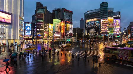 taipei : Taipei, Taiwan- 8 June, 2019: day to night time lapse of traffic and people walking on crosswalk at Ximending with falling rain in Taipei, Taiwan. Ximending is the famous fashion, night Market and street food in Taipei.