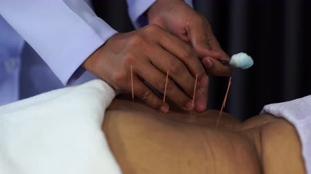 acupressure : Close-up of senior female back with steel needles during procedure of the acupuncture therapy