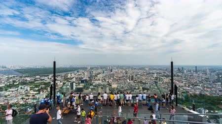 re : Bangkok, Thailand %u2013 Jul 27, 2019 : time lapse of unidentified people with panoramic view on 78th floor at King Power Mahanakhon building rooftop, Bangkok, Thailand
