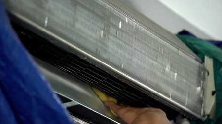 aire acondicionado : slow-motion of technician service cleaning the air conditioner indoors.