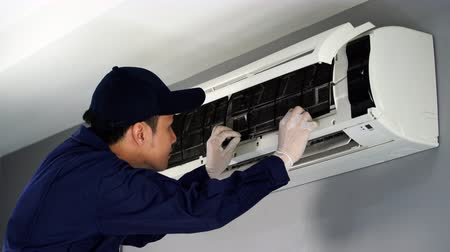 replace : technician service removing air filter of the air conditioner for cleaning