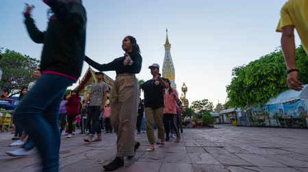 nakhon : NAKHON PHANOM, THAILAND - OCTOBER 12, 2019: time lapse of people ceremony to worship at Wat Phra That phanom in Nakhon Phanom Province, Thailand