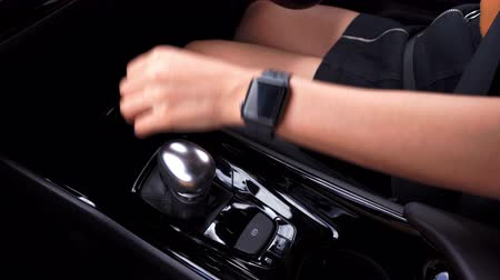 gearstick : Hand of woman changing gear while driving a car