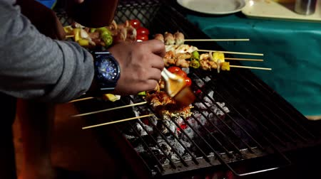 barbequing : grilling barbecue pork stick in street market Stock Footage