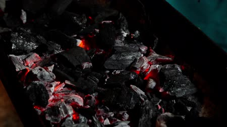 carbon parrilla : slow-moiton of glowing charcoal and flame in the barbecue grill
