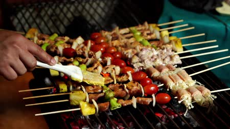 shish kebab : slow-motion of grilling barbecue pork stick
