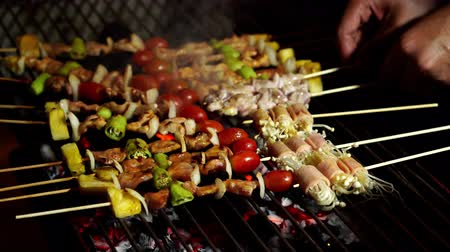 grille : grilling barbecue pork stick in street market Stock Footage