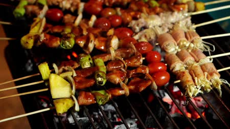 barbequing : slow-motion of grilling barbecue pork stick