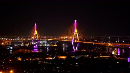 phraya : Bhumibol suspension bridge cross over Chao Phraya River at night in Bangkok city, Thailand Stock Footage
