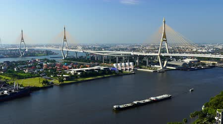 the suspension bridge : panning shot of Bhumibol suspension bridge cross over Chao Phraya River in Bangkok city, Thailand