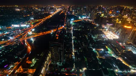 otoyol : BANGKOK, THAILAND - 5 Dec 2019 : time lapse of Bangkok city downtown and expressway road traffic at night of Thailand , Cityscape
