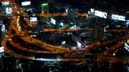 otoyol : BANGKOK, THAILAND - 5 Dec 2019 : Aerial view of expressway junction road at night, view from Baiyoke Tower II in Bangkok, Thailand