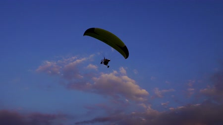 hang gliding : slow-motion of Paraglider flying against a sky Stock Footage