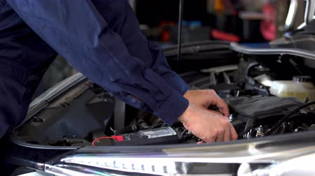 mechanics hand check electrical wiring vehicle system in car service