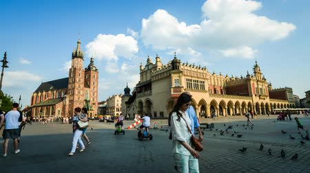 sukiennice : tourists on the main square of Krakow in time lapse